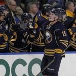 Sabres center Jack Eichel (15) celebrates his second goal of the game with his teammates.